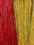 Rot und Goldfunkelndes Lametta Lizenzfreie Stockbilder