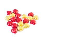 Rot und Goldherz formen Schokolade auf weißem Hintergrund, Liebhaber Co Stockbilder