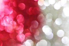 Rot und Silberscheinhintergrund Stockfotografie