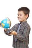 Rotação da criança um globo imagem de stock