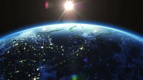 Rotação da terra 360 graus com o Sun Cidades na noite Animação dada laços HD 1080 ilustração stock