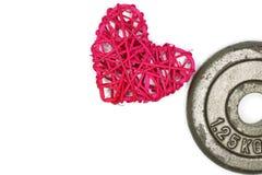 rota de la forma del corazón y una placa del peso fotografía de archivo