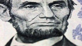 Rotación del billete de dólar del retrato del presidente de Lincoln los E.E.U.U. almacen de metraje de vídeo