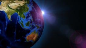 Rotación hermosa de la tierra 360 grados con el Sun en la derecha