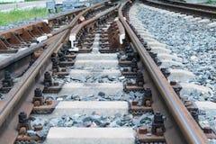 Rotaie e traversine del calcestruzzo Ferrovia della forcella Tiratore della ferrovia fotografia stock