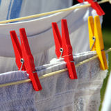 Rotary clothes drier. With different clothes on it stock photo
