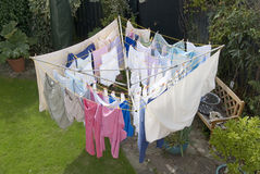 Rotary clothes drying line. Washing hanging out to dry on a rotary clothes line in a domestic garden Royalty Free Stock Photography