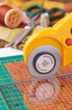 Rotary cutter cuts fabric Stock Photo