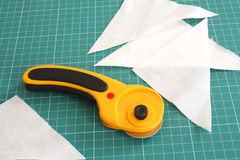 Rotary cutter with fabric Stock Image