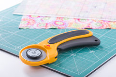 Rotary cutter on a green mat Royalty Free Stock Photos