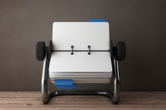 Rotary Desk Card Index. 3d Rendering. Rotary Desk Card Index on a wooden table. 3d Rendering Stock Photos