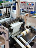 Rotary die cutting machine with slitting. Blade system royalty free stock photos