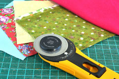 Rotary knife and pieces of cloth for patchwork Stock Photo