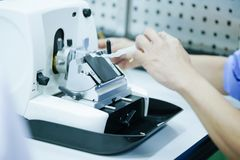 Rotary Microtome Section for diagnosis in pathology make microscope slide histology. Human tissue equipment stock image