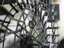 The rotary motion of the water wheel in an old historic watermill in italian village Royalty Free Stock Image
