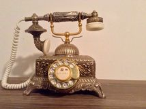 Rotary phone. Beautiful detailed bronze rotary phone royalty free stock photo