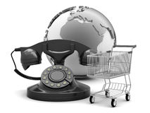 Rotary phone, shopping cart and earth globe Stock Photography