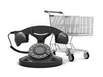 Rotary phone and shopping cart Stock Images