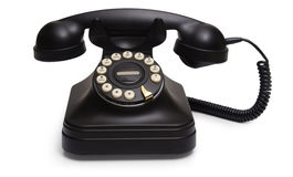 Rotary phone on white. A shot of an antique black desk telephone Stock Photography