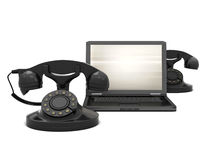 Rotary phones and laptop Royalty Free Stock Photo