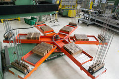 Rotary platform on which the press deposits the aluminum fins. Stock Photo