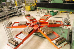 Rotary platform which the press deposits the aluminum fins. Stock Image