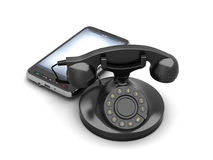 Rotary telephone and modern cell phone Royalty Free Stock Photos