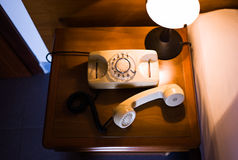 Rotary telephone on night table Stock Photo