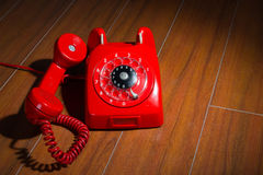 Rotary telephone on wooden background Stock Photo