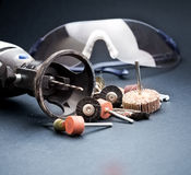 Rotary tools with accessory and safety equipment goggles Royalty Free Stock Images