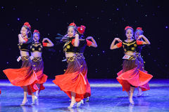 Rotary Turpan girl-Chinese folk dance Royalty Free Stock Photo