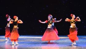 Rotary Turpan girl-Chinese folk dance Royalty Free Stock Photography