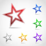 A rotated star icon made of halftone dots. In various versions of coloring Royalty Free Stock Photos