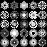 Rotated symmetrical white stencils over black. Set of twenty five white ornamental rotated objects on the black background, monochrome symmetrical vector Royalty Free Stock Photo