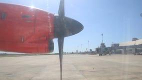 Rotating Aircraft Engine Propeller at Background of Airport. Black rotating aircraft engine propeller at the background of the airport stock video