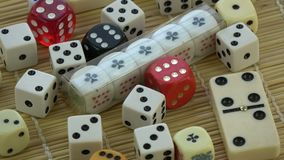 Rotating on bamboo mat group various colorful game dice stock video