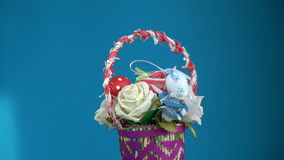 Rotating beautiful colorful Easter basket made from paper and eggs, 4K stock video
