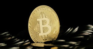 Rotating Bitcoin on a black background stock video footage
