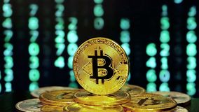 Rotating bitcoin with changed numbers in backgrounds stock footage