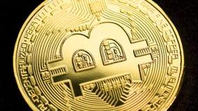 Rotating bitcoin, seamless loop. Bitcoin cryptocurrency rotating seamless loop. Golden crypto coin against black background, macro shot stock footage