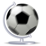 Rotating black and white soccer ball or football and globe Stock Image