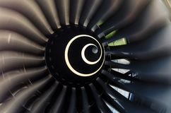 Rotating blades of the blade in the aircraft engine close up. Rotating blades of the blade in the aircraft engine close up royalty free stock image