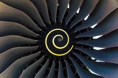 Rotating blades of the blade in the aircraft engine close up. Rotating blades of the blade in the aircraft engine close up stock image