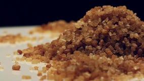 Rotating brown sugar stock footage