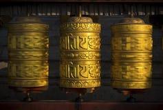 Rotating buddhist prayer wheels as symbol of buddhism religion. And meditation royalty free stock photography