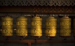 Rotating buddhist prayer wheels as symbol of buddhism religion. And meditation royalty free stock photo