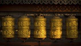 Rotating buddhist prayer wheels as symbol of buddhism religion. And meditation stock photography