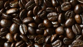 Rotating of coffee beans. 4K stock footage