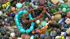 Rotating colorful  indian  old and new beads bracelet. Rotating colorful various indian  old and new beads bracelet background stock video footage