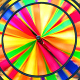 Rotating colorful windmill toy. Abstract background of of colorful childhood windmill toy rotating royalty free stock images